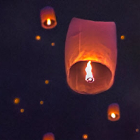 Chinese lanterns in the sky at night