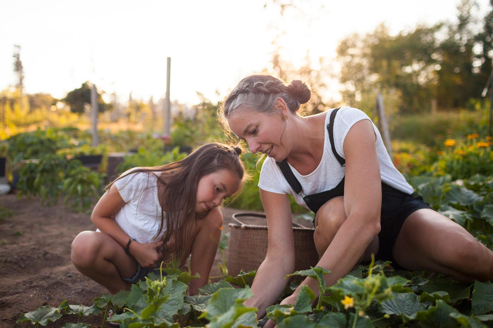 mom and daughter gardening