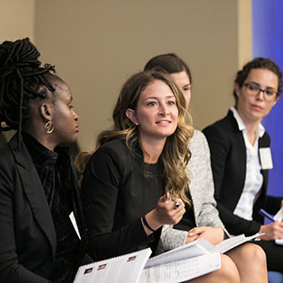Women attend the T. Rowe Price Stock Pitch program event.