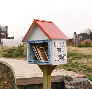 "A ""Little Free Library"" offering free books"